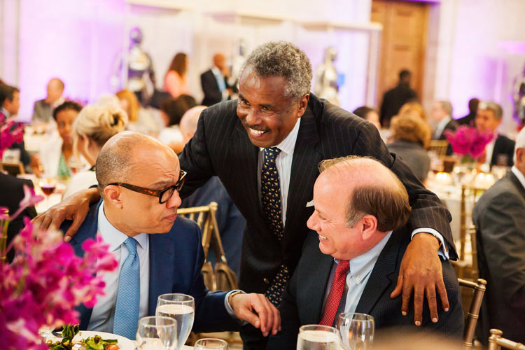 Darren Walker with Ghebre Mehreteab (standing) and Mayor Michael Duggan at the Ford Foundation dinner honoring Detorit partners. June 2015. Detroit, MI. Photo Credit & (c):